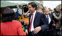 Ed Miliband being egged..Ed Miliband East Street Market Visit. Labour leader Ed Miliband being egged by a member of public during a  living standards related visit to South East London's East Street Market.  This is Milliband's first official visit since coming back from holiday, <br />