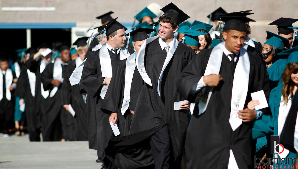 Patrick McKnight looks toward the audience as he marches into Deer Valley High School graduation on Friday, June 10, 2011 in Antioch. (Photo by Kevin Bartram)
