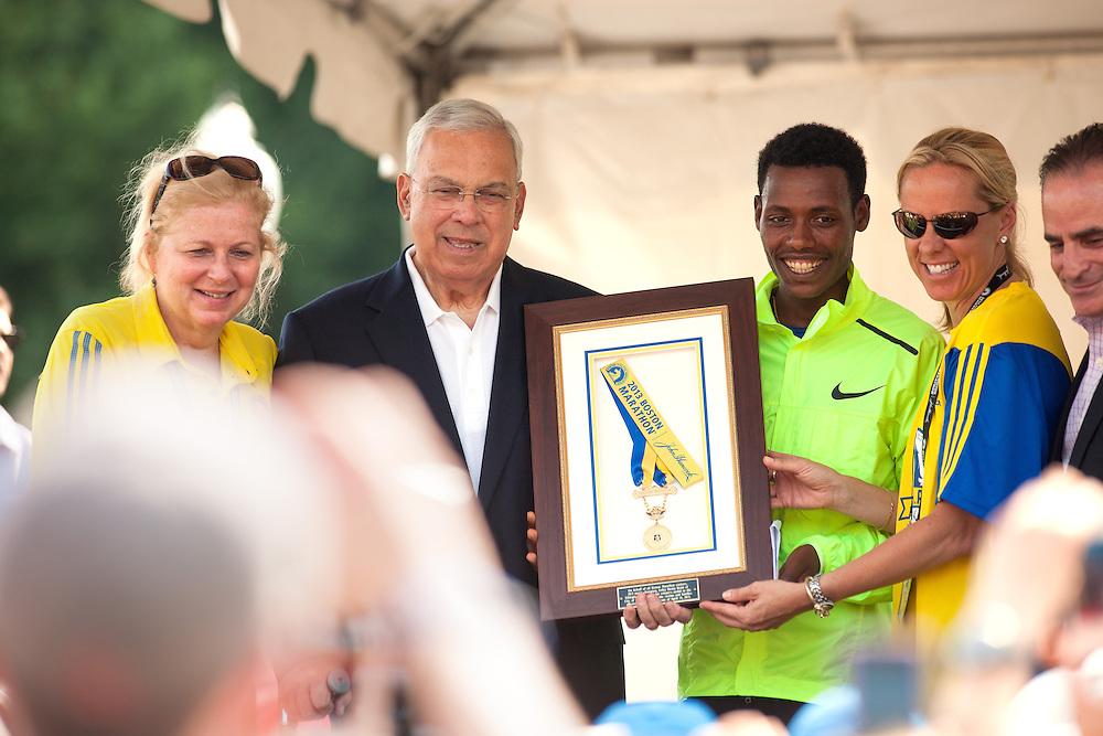 Lilesa Desisa presents Mayor Menino with his winner's medal from Boston Marathon