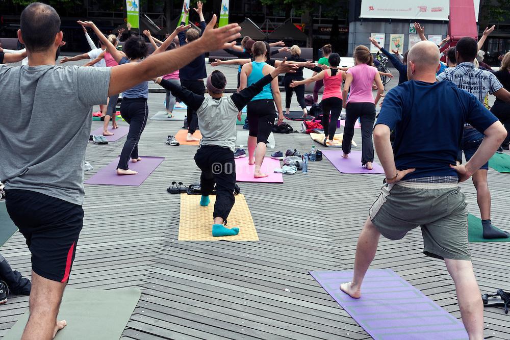 public outdoors yoga style workout