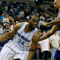 December 21, 2011; New Orleans, LA, USA; New Orleans Hornets power forward Carl Landry (24) drives past Memphis Grizzlies forwardcenter Brian Skinner (3) during the first quarter of a preseason game at the New Orleans Arena.  The Hornets defeated the Grizzlies 95-80. Mandatory Credit: Derick E. Hingle-US PRESSWIRE