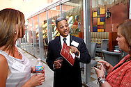 (from left) Annie Bowers of The Envelope stationery boutique; Derrick Strahorn of Strahorn & Company, Attorneys at Law and Lynne Bartley of Silpada Designs jewelry during a BBB/Women in Business Networking event in the atrium of the Kuhn Building in downtown Dayton, Thursday, July 14, 2011.