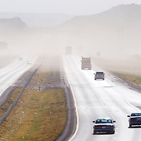 041613       Cable Hoover<br /> <br /> Blowing dust from high winds obscures traffic on Interstate Highway 40 in Gallup Tuesday. Sections of I-40 between Gallup and Flagstaff were closed because of hazardous winds and poor visibility.