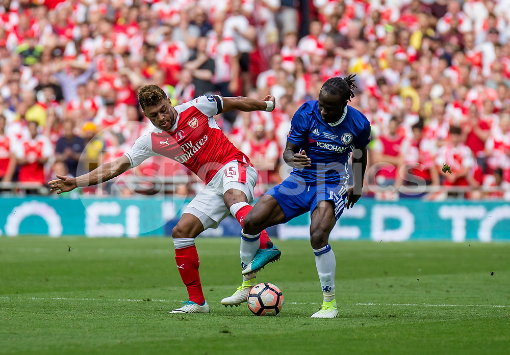 Victor Moses of Chelsea and Alex Oxlade-Chamberlain of Arsenal during the Emirates FA Cup Final between Arsenal and Chelsea at Wembley Stadium, London, England on the 27th May 2017. Photo by Liam McAvoy.