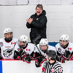 GEORGETOWN, ON - JANUARY 23: Scott McCrory Head Coach of the Georgetown Raiders laughs with the referee during a stoppage in play during the first period on January 23, 2019 at Gordon Alcott Memorial Arena in Georgetown, Ontario, Canada.<br /> (Photo by Ryan McCullough / OJHL Images)