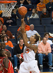 Virginia guard Sylven Landesberg (15) finishes to the basket against VMI.  The Virginia Cavaliers defeated the Virginia Military Institute Keydets 107-97 in NCAA Basketball at the John Paul Jones Arena on the Grounds of the University of Virginia in Charlottesville, VA on November 16, 2008.