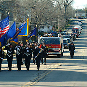 "BATH, Maine -- 12 /16/ 06 -- The funeral procession for  Bath City Councilor and Fireman John C. ""Jack"" Hart Jr.  traveled from the Bath Middle School down North St to High St and finished at the Fire Station. Photo by Roger S. Duncan ."