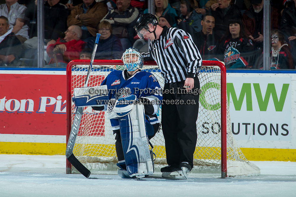 KELOWNA, CANADA - FEBRUARY 12: Griffen Outhouse #30 of the Victoria Royals kneels in net and speaks to lineman Cody Wanner during second period  on February 12, 2018 at Prospera Place in Kelowna, British Columbia, Canada.  (Photo by Marissa Baecker/Shoot the Breeze)  *** Local Caption ***