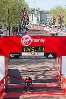 Tatyana McFadden of the USA crosses the finishing line in a time of 01:45:12 to win the Women's Wheelchair race at the Virgin Money London Marathon 2014 at the finish line on Sunday 13 April 2014<br /> Photo: Dillon Bryden/Virgin Money London Marathon<br /> media@london-marathon.co.uk