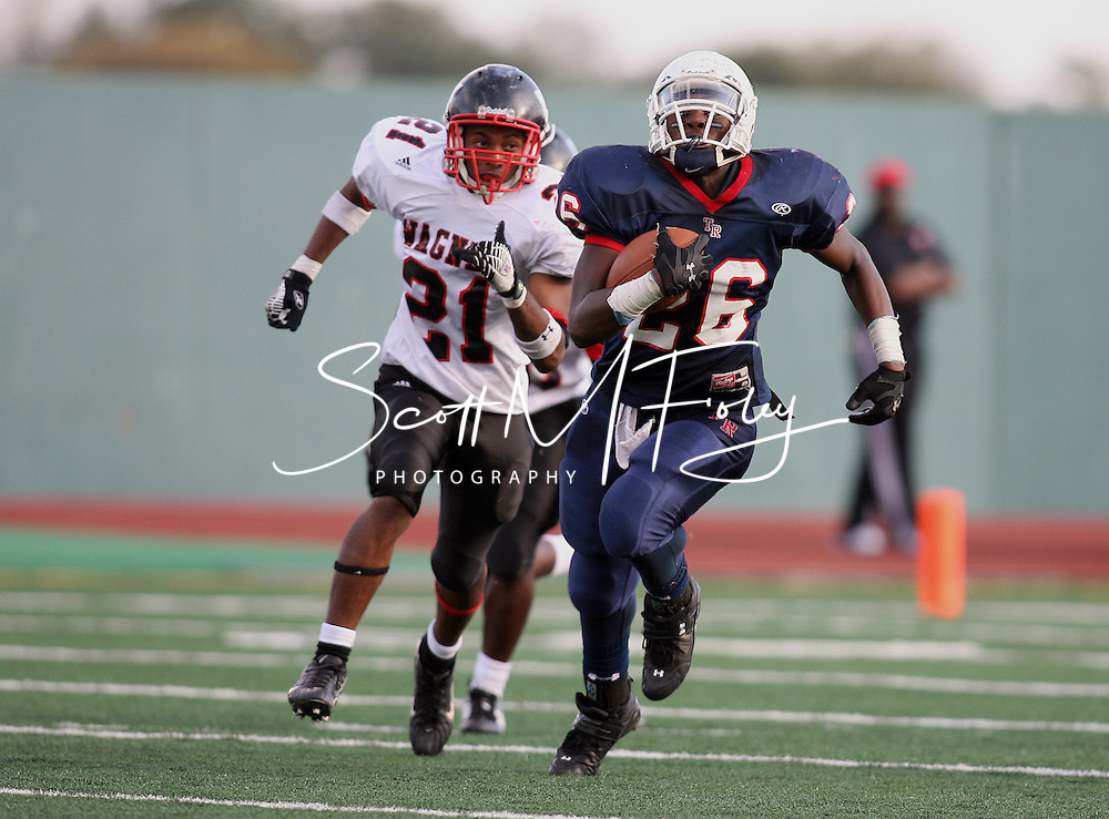 Roosevelt's Running Back Marquis Foster breaks into the secondary and has a huge gain during game action, Season finale, matches up Roosevelt Rough Riders vs. Wagner Thunderbirds, 10 November 2007, Comalander Stadium, San Antonio, TX, Texas High School Football , Roosevelt 37, Wagner 25.