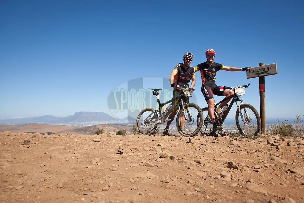 Craig Cameron and Laurence Szendrei take a break during the Prologue of the 2012 Absa Cape Epic Mountain Bike stage race held at Meerendal Wine Estate in Durbanville outside Cape Town, South Africa on the 25 March 2012..Photo by Nick Muzik/Cape Epic/SPORTZPICS