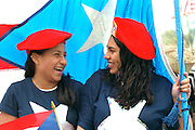Women age 17 carrying the Puerto Rican flag in Cinco de Mayo parade.  St Paul Minnesota USA