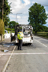 Pictured: Owners pick over what is left f their burnt out van on ehr junction of Bog Road and Carlops Road in Penicuik.  No injuries were reported in what appears to be a case of spontaneous combustion<br /> <br /> <br /> <br /> Ger Harley | EEm 26 August 2017