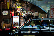 Evening street life in Tokyo. Tokyo has 13.01 million inhabitans, is the Japanese capital and the largest city in Japan. Tokyo, Japan, 20.10 2010. Tokyo, Japan, 20.10 2010.