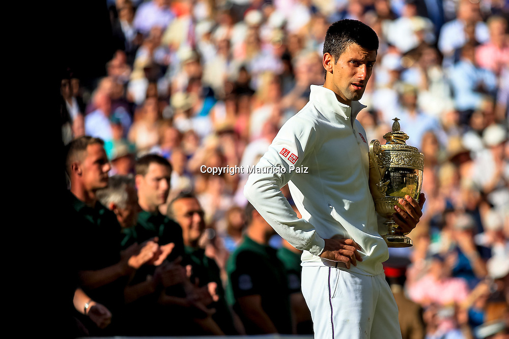 LONDON, ENGLAND - JULY 06: Novak Djokovic of Serbia poses with trophy in tears during the Gentlemen's Singles match following his victory in the Gentlemen's Singles Final match against Roger Federer of Switzerland on day thirteen of the Wimbledon Lawn Tennis Championships at the All England Lawn Tennis and Croquet Club on July 6, 2014 in London, England.