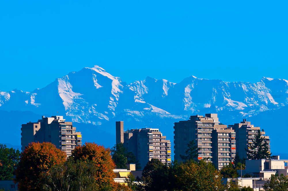 Apartment buildings on the outskirts of Bern, with peaks of the Swiss Alps behind, Canton Bern, Switzerland