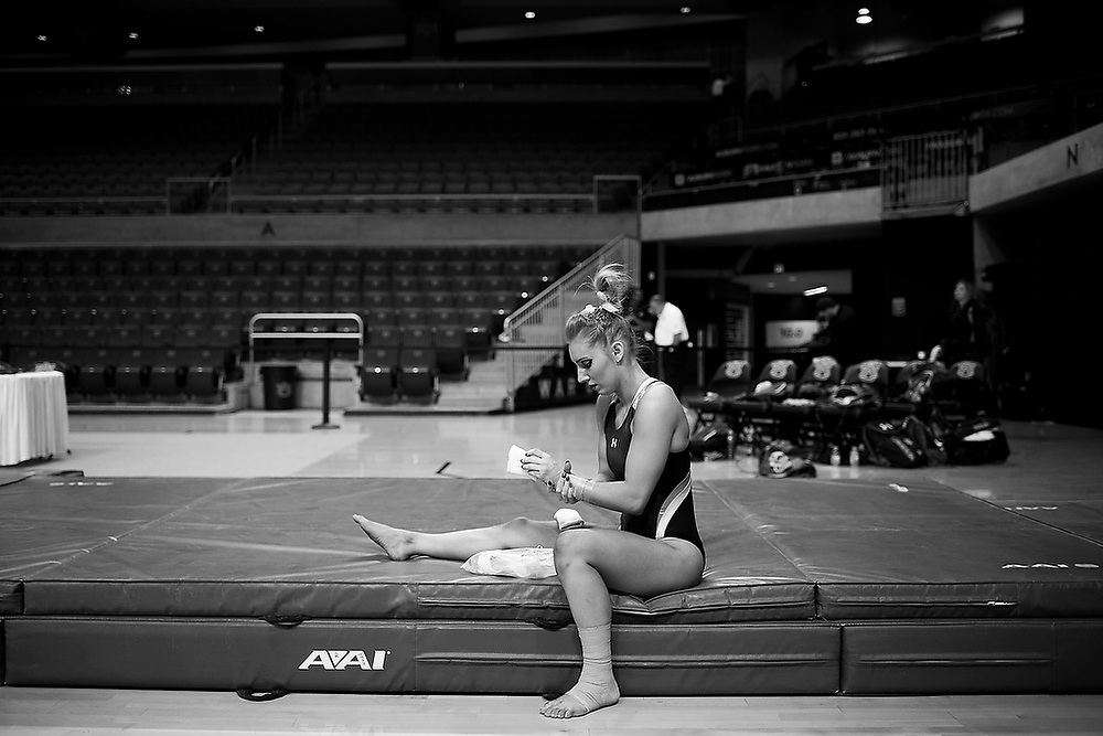 Auburn's Kait Kluz wraps her wrists in tape before warming up for the meet between the No. 8 Auburn Tigers and No. 4 Alabama Crimson Tide. <br /> No. 4 Alabama Crimson Tide vs. No 8 Auburn Tigers at Auburn Arena in Auburn, Ala. on Friday, Feb. 12, 2016. <br /> Zach Bland/Auburn Athletics