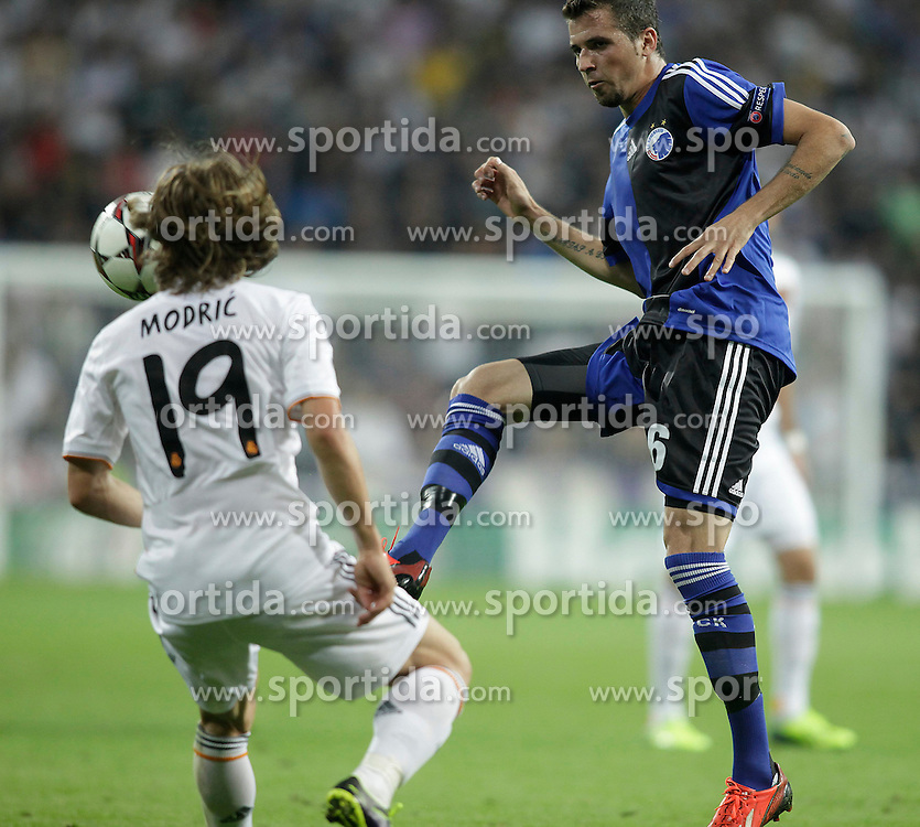 02.10.2013, Estadio Santiago Bernabeu, Madrid, ESP, UEFA Champions League, Real Madrid vs FC Kopenhagen, Gruppe B, im Bild Real Madrid Modric (L) and FC Kopenhagen Claudemir // during the UEFA Champions League Group B match between Real Madrid and FC Kopenhagen at the Estadio Santiago Bernabeu, Madrid, Spain on 2013/10/02. EXPA Pictures &copy; 2013, PhotoCredit: EXPA/ Alterphotos/ Ricky Blanco<br /> <br /> ***** ATTENTION - OUT OF ESP and SUI *****
