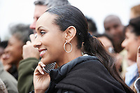 Woman Using Cell Phone in Crowd side view head and shoulders