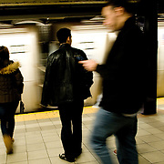 Commuters wait for a train to stop at the Port Authority subway station in New York, February 19, 2010.