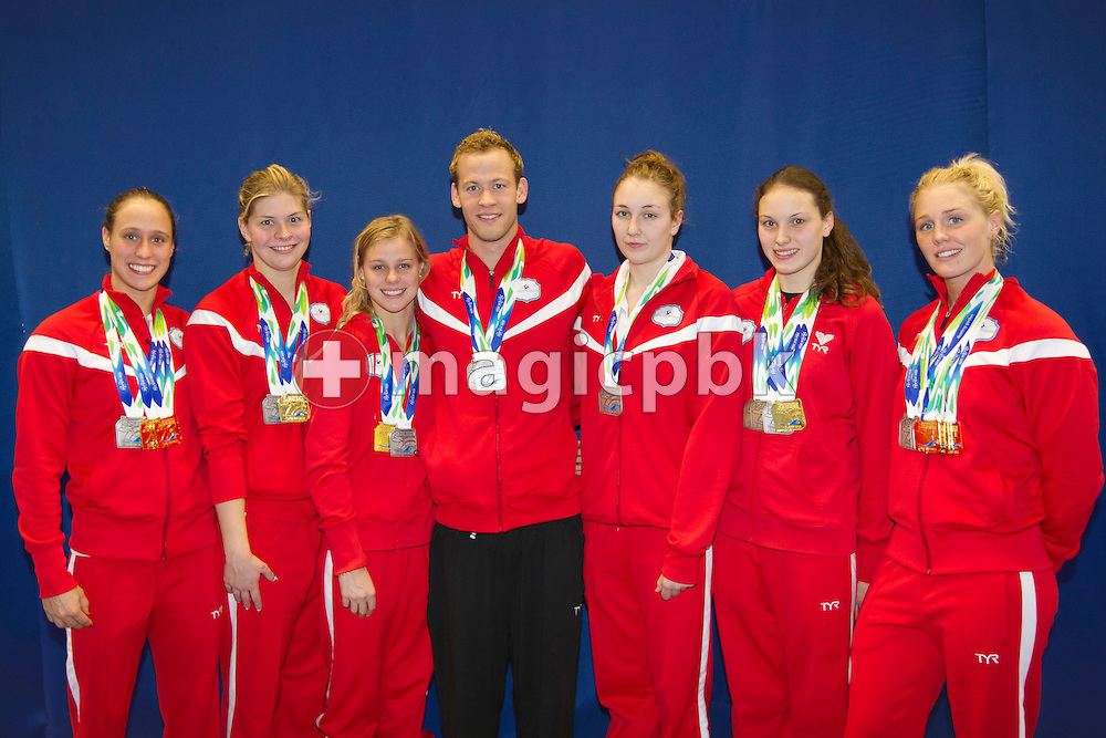 (L-R) The Danish medalists Rikke Moeller PEDERSEN, Lotte FRIIS, Pernille BLUME, Mads GLAESNER, Katrine Holm SOERENSEN, Mie Ostergaard NIELSEN and Jeanette OTTESEN of Denmark poses with all their won medals at the 15th European Short Course Swimming Championships in Szczecin, Poland, Sunday, Dec. 11, 2011. (Photo by Patrick B. Kraemer / MAGICPBK)