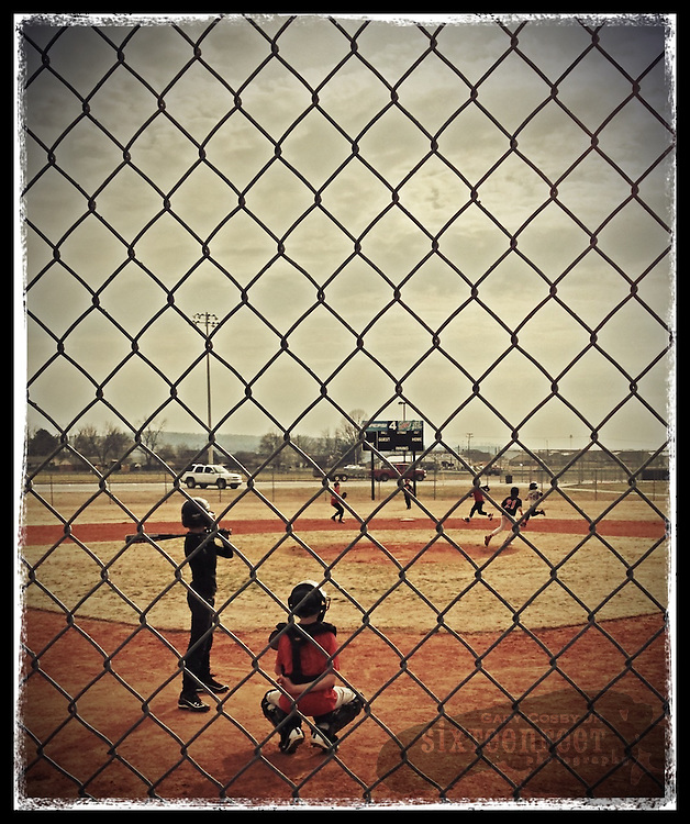 Gary Cosby Jr.  iPhone photographs Children practice baseball in Priceville, Alabama.