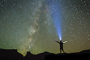 A man stands silhouetted against the stars.<br /> Moab, Utah