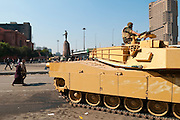 A tank and soldier sit in Abdel Moniem Riad Square in downtown Cairo during anti-government demonstrations. The building on the right is the Ramses Hilton; on the left is the Egyptian Museum and, behind it, the burned out ruling party headquarters. (Cairo, Egypt - February 2, 2011)