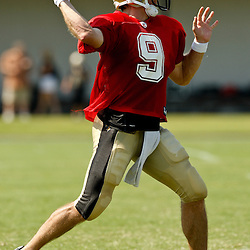 July 31, 2010; Metairie, LA, USA; New Orleans Saints quarterback Drew Brees (9) throws a pass during a training camp practice at the New Orleans Saints practice facility. Mandatory Credit: Derick E. Hingle