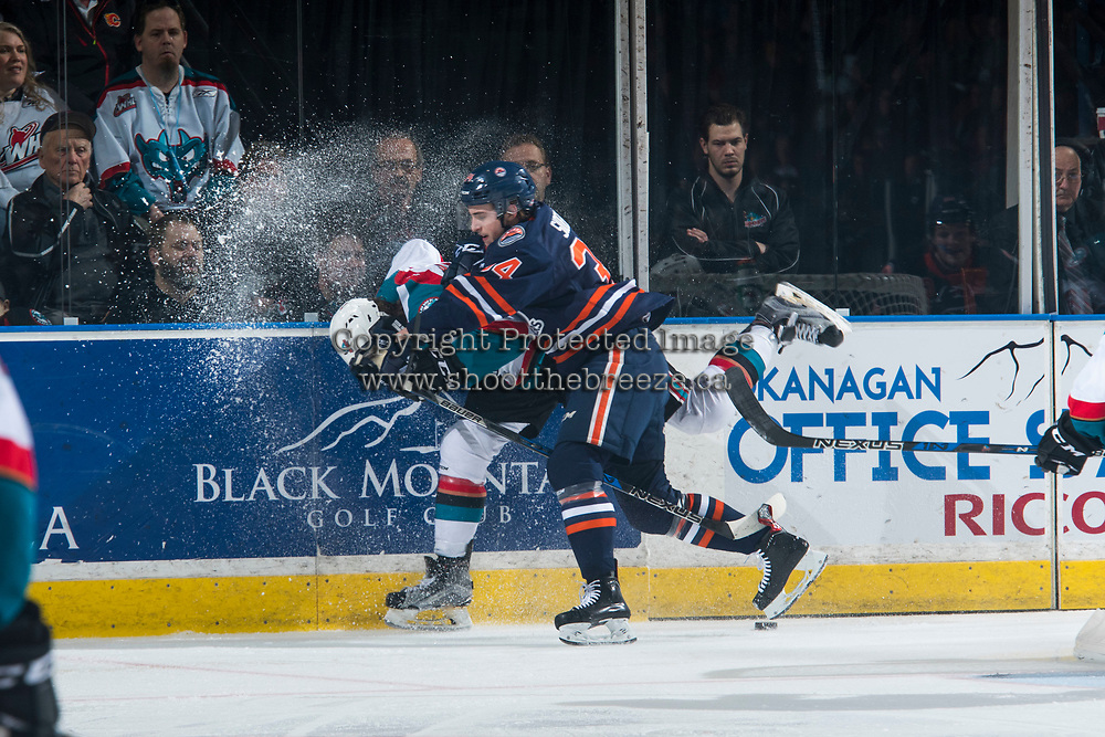 KELOWNA, CANADA - MARCH 25: Deven Sideroff #34 of the Kamloops Blazers checks Lucas Johansen #7 of the Kelowna Rockets into the boards behind the net during second period on March 25, 2017 at Prospera Place in Kelowna, British Columbia, Canada.  (Photo by Marissa Baecker/Shoot the Breeze)  *** Local Caption ***