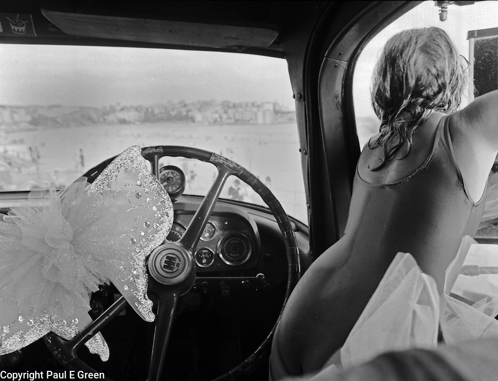 Photography of Sydney by Paul Green,angel wings, hotty the fire truck,maddison carrette in madam lash's fire truck at bondi beach, black and white,
