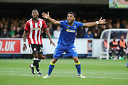 AFC Wimbledon striker Andy Barcham (17) appealing for a penalty during the EFL Cup match between AFC Wimbledon and Brentford at the Cherry Red Records Stadium, Kingston, England on 8 August 2017. Photo by Matthew Redman.