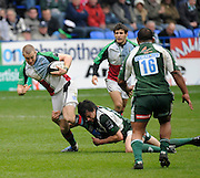 Reading, GREAT BRITAIN, Exiles', Danie COETZEE, tackles, Mike BROWN low, during the Guinness Premiership game, London Irish vs Harlequins, 19.04.2008 [Mandatory Credit Peter Spurrier/Intersport Images]