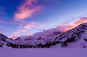 Sunset over the Sierra crest in winter, John Muir Wilderness, Sierra Nevada Mountains, California  USA