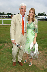 STEVEN & SOPHIE LUSSIER she is a member of the De Beers Diamond family at the King George VI and The Queen Elizabeth Diamond Stakes sponsored by De Beers held at Newbury Racecourse, Berkshie on 23rd July 2005.<br />