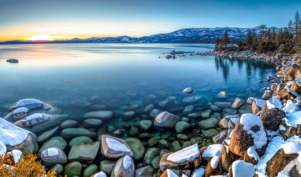"""Tahoe Boulders at Sunset 17"" - Stitched panoramic sunset photograph of snow covered boulders along the shore of Lake Tahoe, near Hidden Beach."