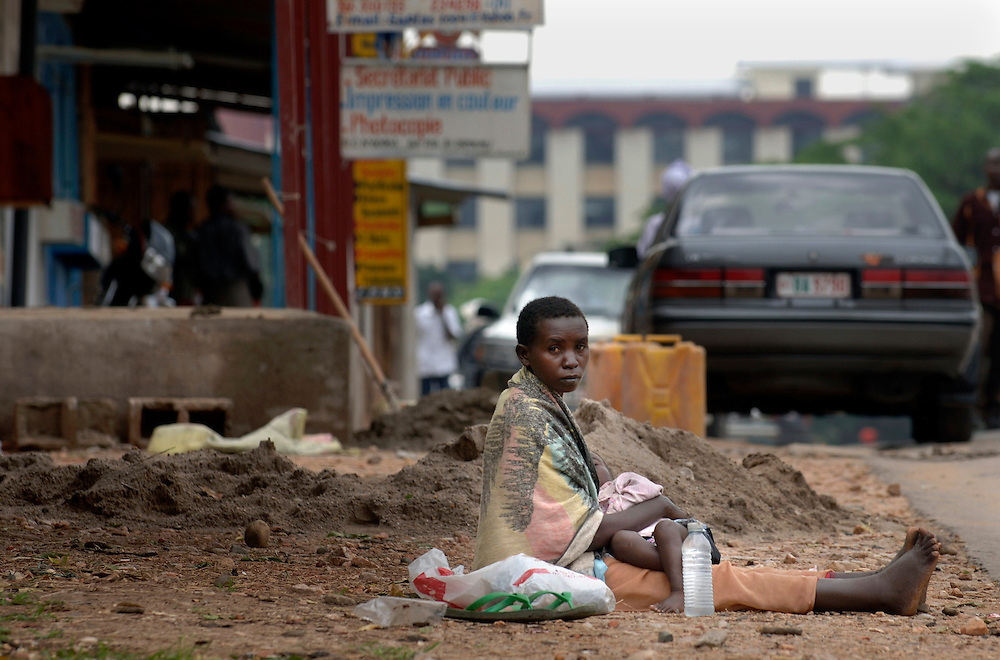 Burundi, November 28, 2005 -  Homeless mother with her child at the street in Bujumbura.