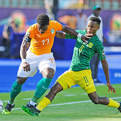 Serge Aurier of Ivory Coast is tackled by Themba Zwane of South Africa during the 2019 Africa Cup of Nations Finals game between Ivory Coast and South Africa at Al Salam Stadium in Cairo, Egypt on 24 June 2019  <br /> Photo : Icon Sport