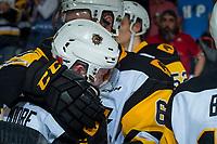 REGINA, SK - MAY 25: Riley Stillman #61 and Ryan Moore #40 of Hamilton Bulldogs hug after the loss to the Regina Pats at the Brandt Centre on May 25, 2018 in Regina, Canada. (Photo by Marissa Baecker/CHL Images)