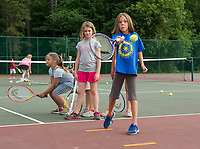 Macy Swornstedt concentrates on her forehand swing during tennis lessons at Memorial Park on Tuesday evening.  (Karen Bobotas/for the Laconia Daily Sun)