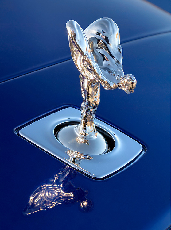 "2015 Rolls Royce Wraith, Salamanca Blue.  Close up of the ""spirit of Ecstasy"" hood ornament"