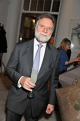 DR TIM EVANS he is the Queen's GP – Apothecary to Her Majesty and the Royal Household at a party to celebrate the publication of Fame Game by Louise Fennell held at Grace, West Halkin Street, London on 12th March 2013.