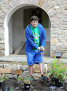 Jack Dence, 14 of Falls Township, Pennsylvania digs a hole for a plant at Three Arches as part of the 14th annual Comcast Cares Day Saturday April 25, 2015 Falls Township, Pennsylvania. (Photo by William Thomas Cain/Cain Images)