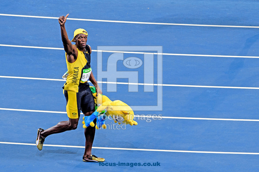 Usain Bolt of Jamaica retains his title and wins his third successive Gold Medal in the Men's 100m on day nine of the XXXI 2016 Olympic Summer Games in Rio de Janeiro, Brazil.<br /> Picture by EXPA Pictures/Focus Images Ltd 07814482222<br /> 14/08/2016<br /> *** UK &amp; IRELAND ONLY ***<br /> <br /> EXPA-EIB-160815-0063.jpg