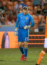 August 4, 2018 - Houston, TX, U.S. - HOUSTON, TX - AUGUST 04:  Houston Dynamo goalkeeper Joe Willis (23) reacts after failing to trap a shot on goal and allowing Sporting KS to score during the soccer match between Sporting Kansas City and Houston Dynamo on August 4, 2018 at BBVA Compass Stadium in Houston, Texas.  (Photo by Leslie Plaza Johnson/Icon Sportswire) (Credit Image: © Leslie Plaza Johnson/Icon SMI via ZUMA Press)