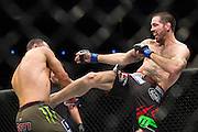 DALLAS, TX - MARCH 14:  Matt Brown hits Johny Hendricks with a kick during UFC 185 at the American Airlines Center on March 14, 2015 in Dallas, Texas. (Photo by Cooper Neill/Zuffa LLC/Zuffa LLC via Getty Images) *** Local Caption *** Matt Brown; Johny Hendricks