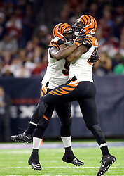 Cincinnati Bengals' Wallace Gilberry, left, and Michael Johnson celebrate after sacking Houston Texans quarterback Tom Savage during the first half of an NFL football game Saturday, Dec. 24, 2016, in Houston. (AP Photo/Sam Craft)