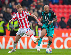 STOKE-ON-TRENT, ENGLAND - Saturday, January 25, 2020: Stoke City's Sam Clucas and Swansea City's André Ayew during the Football League Championship match between Stoke City FC and Swansea City FC at the Britannia Stadium. (Pic by David Rawcliffe/Propaganda)