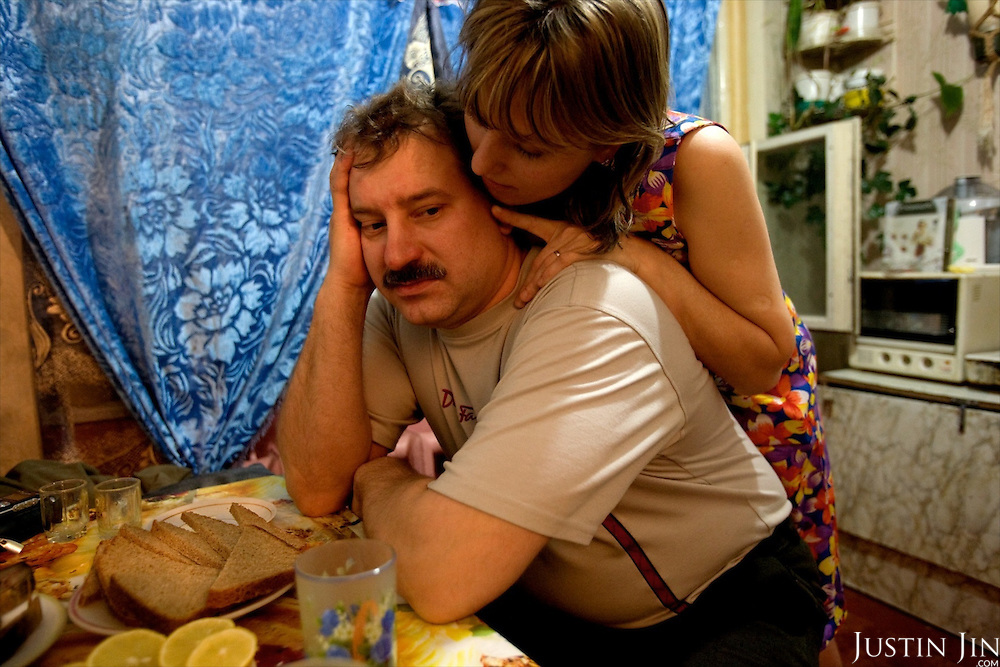 Valery Zhukov, a miner and union representative in Severny village outside Vorkuta, and who is married with a daughter, is comforted by his lover Lena who lives in the same neighborhood..Vorkuta is a coal mining and former Gulag town 1,200 miles north east of Moscow, beyond the Arctic Circle, where temperatures in winter drop to -50C. .Here, whole villages are being slowly deserted and reclaimed by snow, while the financial crisis is squeezing coal mining companies that already struggle to find workers..Moscow says its Far North is a strategic region, targeting huge investment to exploit its oil and gas resources. But there is a paradox: the Far North is actually dying. Every year thousands of people from towns and cities in the Russian Arctic are fleeing south. The system of subsidies that propped up Siberia and the Arctic in the Soviet times has crumbled. Now there's no advantage to living in the Far North - salaries are no higher than in central Russia and prices for goods are higher.