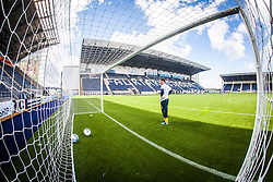 Falkirk FC keeper Michael McGovern seen through the net during the warm-up.The Falkirk Stadium, with the new pitch work for the Scottish Championship game v Morton. The woven GreenFields MX synthetic turf and the surface has been specifically designed for football with 50mm tufts compared with the longer 65mm which has been used for mixed football and rugby uses.  It is fully FFA two star compliant and conforms to rules laid out by the SPL and SFL.<br /> &copy;Michael Schofield.